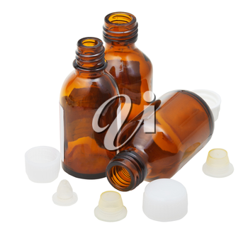 three empty little open amber glass oval pharmacy bottles isolated on white background