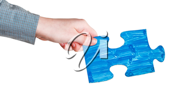 female hand with painted blue puzzle piece isolated on white background