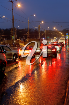 urban traffic in rainy evening in Moscow