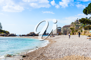 TAORMINA, ITALY - APRIL 3, 2015: beach Isola Bella island on Ionian Sea, Sicily. Also known as The Pearl of the Ionian Sea in 1990 the island being turned into nature reserve, administrated by WWF