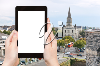 travel concept - tourist photograph cityscape with St Laud's Church in Angers, France on tablet pc with cut out screen with blank place for advertising logo