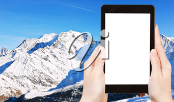travel concept - tourist photograph MontBlanc mountain in Alps in Portes du Soleil region, Evasion - Mont Blanc, France on tablet pc with cut out screen with blank place for advertising logo