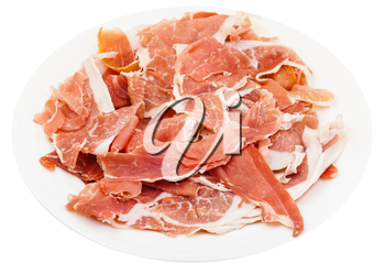 thin sliced dry-cured ham on white plate isolated on white background