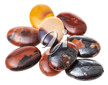 many oval beads from mookaite (Australian jasper) gemstone isolated on white background