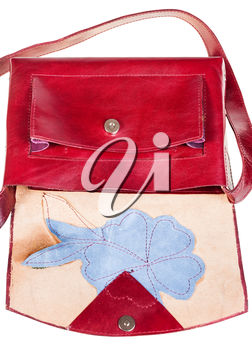 open dark cherry color handbag decorated by flower applique isolated on white background