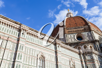 travel to Italy - bottom view of dome of Florence Duomo Cathedral (Cattedrale Santa Maria del Fiore, Duomo di Firenze, Cathedral of Saint Mary of the Flowers) from Piazza del Duomo in Florence city