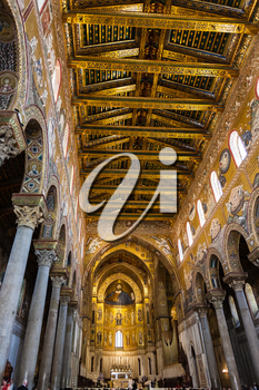 MONREALE, ITALY - JUNE 25, 2011: interior of Duomo di Monreale in Sicily. The cathedral of Monreale is one of the greatest examples of Norman architecture, it was begun in 1174