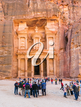 PETRA, JORDAN - FEBRUARY 21, 2012: people in front of al-Khazneh temple (The Treasury) in Petra town. Rock-cut town Petra was established about 312 BC as the capital city of the Arab Nabataean