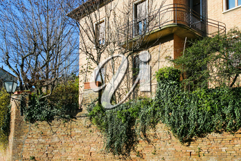 travel to Italy - residential house on street in Siena city in winter evening