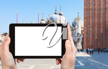 travel concept - tourist photograps St Mark's Square (Piazza San Marco) with cathedral, campanile in Venice city in Italy in spring on tablet with cut out screen for advertising logo