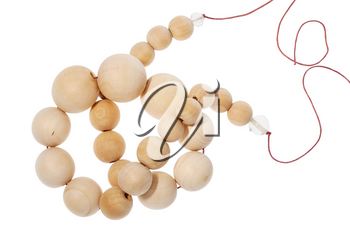 top view of tangled string of wooden beads isolated on white background