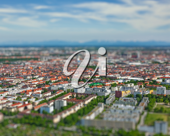 Aerial view of Munich from Olympiaturm Olympic Tower. Munich, Bavaria, Germany with tilt shift toy effect shallow depth of field