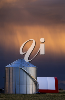Storm Clouds Saskatchewan and farm storage granary
