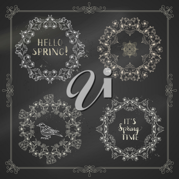 Cherry blossoms on tree branches on blackboard background. Handwritten grunge brush lettering. There is copyspace for your text in the center.