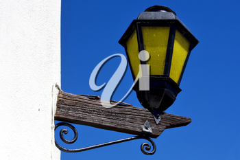 a street lamp and a wall in calle de los suspiros in colonia del sacramento uruguay