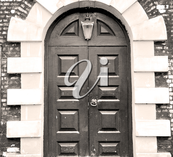wooden parliament in london old church door and marble antique  wall