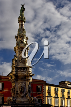 marble statue of obelisk immacolata  in the centre of naples italy church