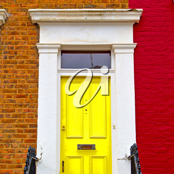 notting hill in london england old suburban and antiqueyellow    wall door