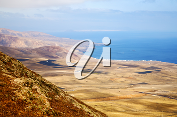 coastline lanzarote view from the top in  spain africa and house field