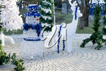 New Year's scenery deer and snowman, subject New Year and Christmas holidays, winter