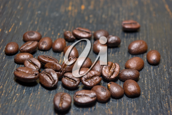 The fragrant fried coffee beans grunge background