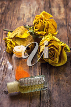 fragrant yellow roses and retro bottle with spirits
