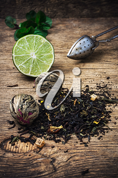tea brew with lime and mint on wooden background in rustic  style
