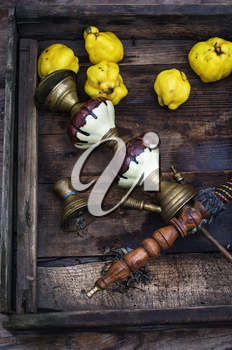 Stylish hookah disassembled in wooden box with fragrant autumn fruit quince.