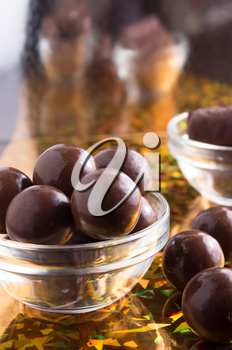 Chocolate candy round close-up on a colorful background with blur and a small depth of focus