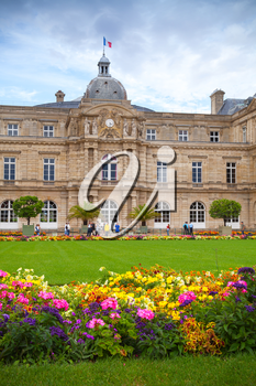 Paris, France - August 10, 2014: Luxembourg Palace and colorful flowers of the Luxembourg Garden in Paris