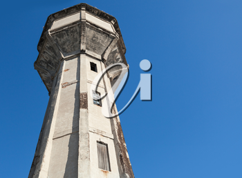 Old abandoned water tower above blue sky. Tallinn, Estonia