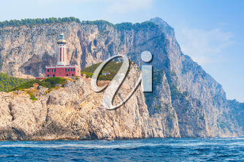Punta Carena. Lighthouse stands on the rocky coast of Capri island, Italy