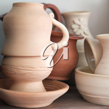 Pottery examples on the shelf in the art school