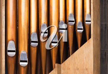 Closeup photo of shining organ tubes, classical music background photo