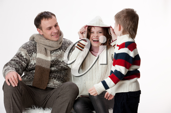 Young woman, man and boy on isolated studio background