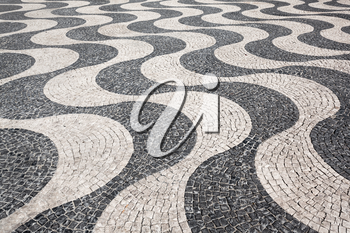 Waves of tiled floor in portuguese traditional style, Rossio square, Lisbon