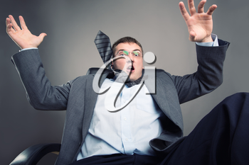 Frightened office worker put his hands up