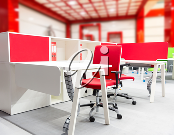 Office worker's place with modern interior in red tones