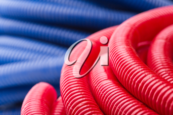 Rolls of red and blue pipes