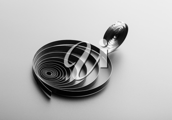 Two metallic spirals on grey background