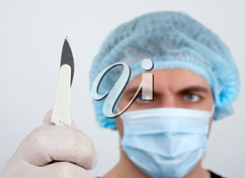 Portrait of serious surgeon with surgical knife