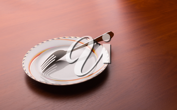 White plate and fork on the table