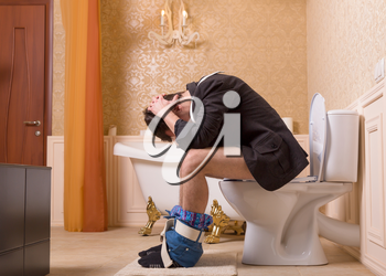 Diarrhea or constipation problem concept. Man with pants down sitting on the toilet bowl