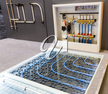 Floor heating distributor, exhibition sample in the store. Mounting or installation scheme, warm house control