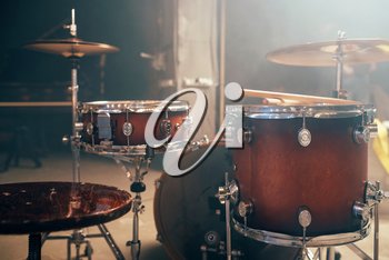 Drum-kit, drum-set, percussion instrument on the stage with lights, nobody. Drummer professional equipment, beat set