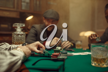 Professional poker player playing in casino. Games of chance addiction. Man with cards in hands leisures in gambling house