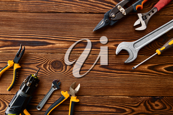 Workshop tools, macro view, wooden background, nobody. Professional instrument, carpenter or builder equipment, screwdriver and wrench, piles and metal scissors
