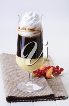 Glass of liqueur coffee with whipped cream