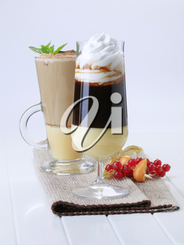 Two coffee drinks in tall glasses - still life