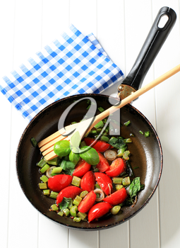 Sauteeing vegetables in a fry pan